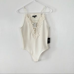 Express ivory deep plunge body suit